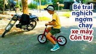 Bé trai nghịch ngợm chạy xe máy Côn tay của Bố... suýt rớt nài.