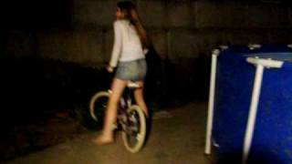 Cinderella Rides A Bike in the Dark, Wearing a Denim Mini-Skirt
