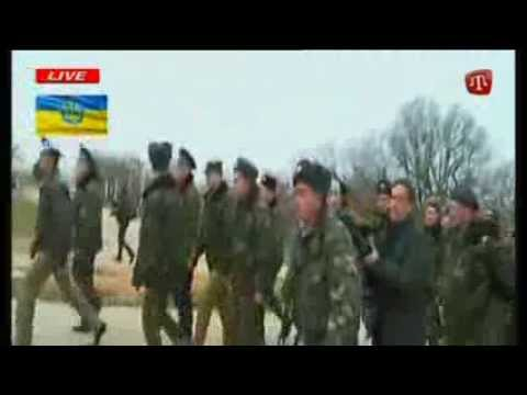 Warning shots fired at Ukrainian soldiers - by Russian troops - as Ukrainians march towards Belbek air base in Crimea, which is under control of Russians -- firing can be heard as Ukrainians...