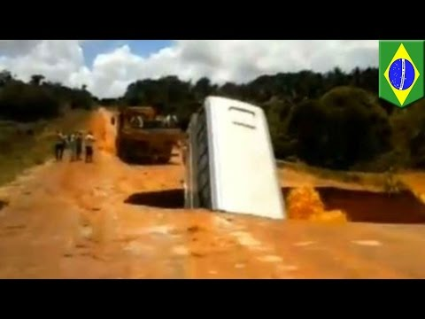 Caught on tape: Bus plunges through massive sinkhole seconds after passengers exit