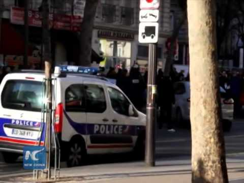 Man attempts to attack Paris police, shot dead
