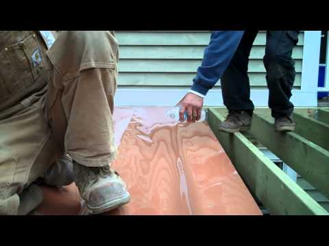 Your Deck Co. Installing  Trex Rain Escapes