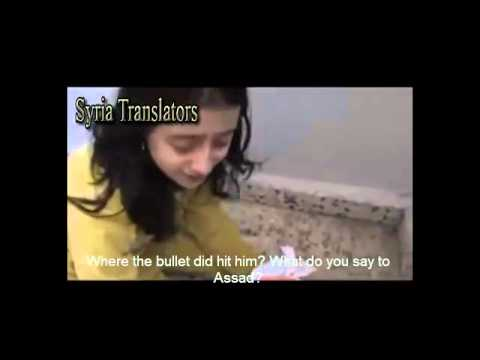 Syria, Homs A child is in shock, crying over her martyred father. killed by Assad