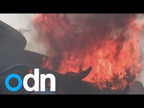 Putin effigy burns in northern Ukraine protest