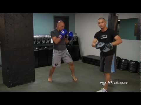 Boxing Basics: How to Use Focus Mitts to Train Punching Combinations Image 1