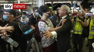Riot officers try to disperse protesters occupying Hong Kong airport