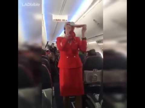 Spaniards having fun with a flight attendant