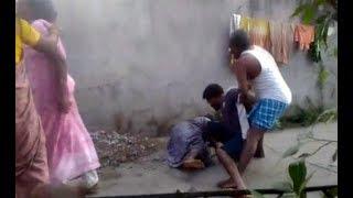 Congress Worker Attack Women In Peddapalli | కుక్క మూత్ర విసర్జన చేసింది.. విచక్షణా రహితంగా దాడి