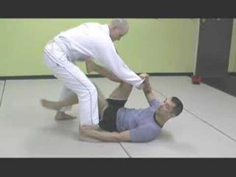 BJJ Basics: How To Do The Spider Guard Sickle Sweep Image 1