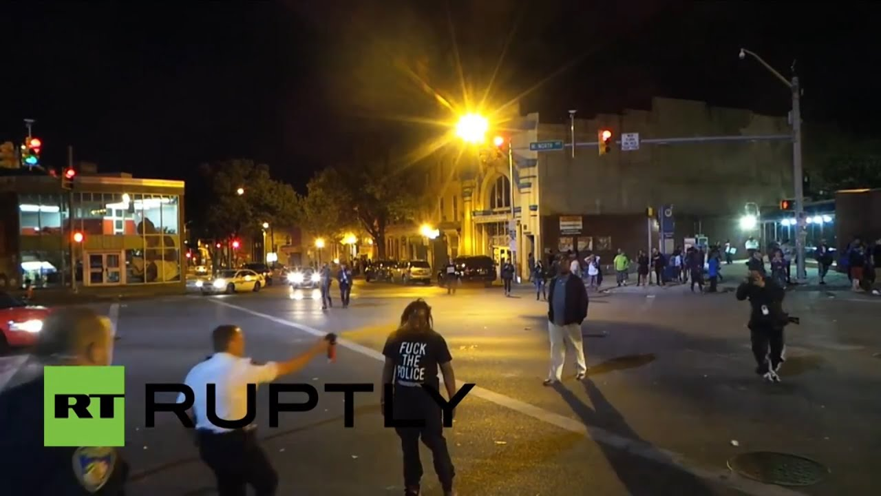 RAW: Baltimore police pepper spray protester point blank in face