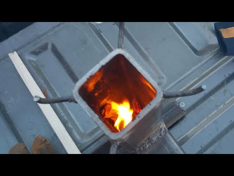 Lighting the 30-minute rocket stove for the first time   Redneck Homestead