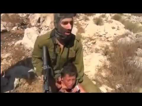 Nidokidos   Palestinian women scuffle with Israeli soldier