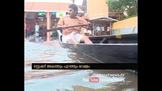 Flooded entrance and road leading to the Chengannur Railway Station