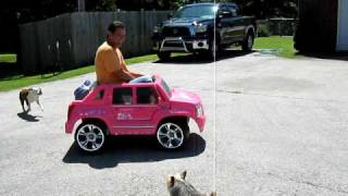 Dad in a pink car