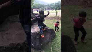 funny baby jumping off a rock| jumping| rock| baby jumping| fun| kid jumping