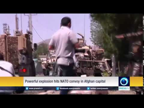A powerful explosion hits a NATO military convoy in the Afghan capital Kabul