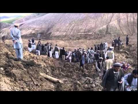 Afghanistan landslide buries remote village, killing 52