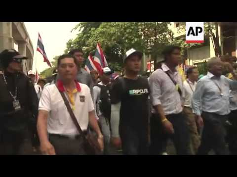 Thousands of anti-government protesters marched through the streets of Bangkok calling for the resig