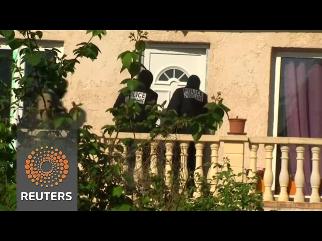 Police search home of shooting suspect in Paris suburb