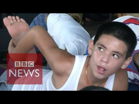 Can yoga bring peace to Caracas slums? BBC News