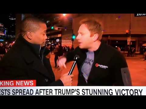 "CNN cameraman BUSTED pretending to be ""ANTI TRUMP"" protestor"