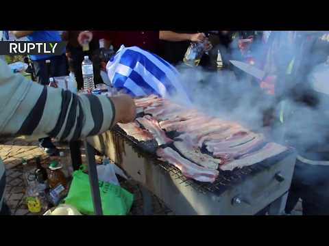 Anti-migrant pork-and-alcohol BBQ held near Diavata refugee camp in Greece