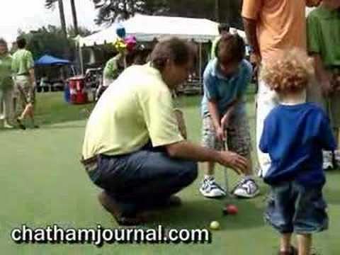 Jeff Foxworthy and Gene Banks putt around with the kids