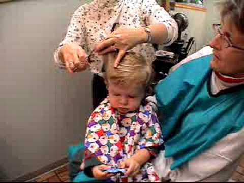Dawn Marie giving Alec his first haircut.