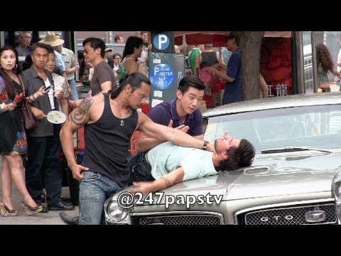 Taylor Lautner gets SLAMMED on top of a car while Filming in NYC (06-24-13)