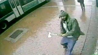 Hombre es abatido tras herir a dos agentes en Nueva York con un hacha