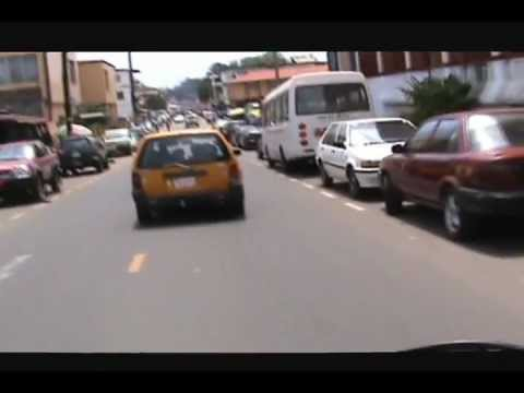 Motorcycle taxi through Monrovia, Liberia.wmv