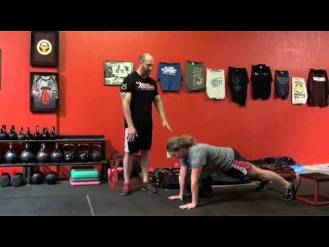 Men's Health Ultimate Sandbag Training Workout Image 1