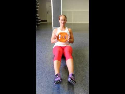 Bålträning med viktskiva med sidrotation