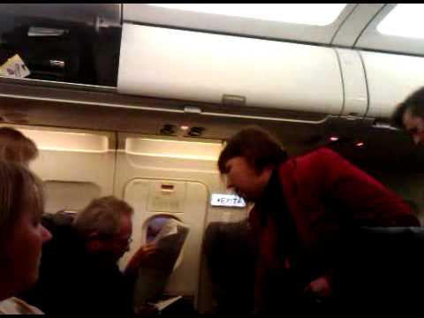 Crazy woman kicked off airplane