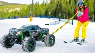 HUGE RC CAR SKI TOWING!! (TRAXXAS XMAXX)