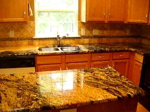 Exotic Granite Countertops With Tile Backsplash
