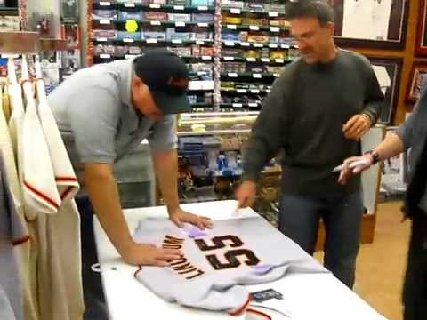 Tim Lincecum was signing a jersey for a customer while discussing the Manny Pacquiao vs Oscar De La Hoya fight. He accidently signed his name twice on the jersey when he should have inscribed...