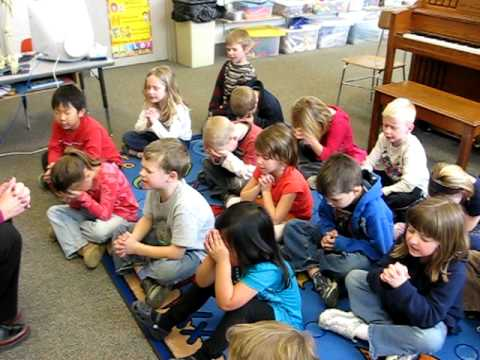 Dutton Christian School's kindergarten class praying before lunch.
