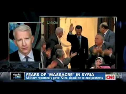A Syrian opposition activist gives CNN