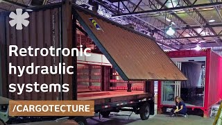 Hydraulic doors transform containers in retrotronic shelters