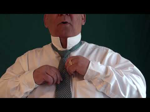 Demonstration Of A Full Windsor Tie Knot.