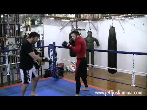 MMA/Muay Thai Striking Technique - Outside Low Kick Setup (Coralling with the Jab) Image 1