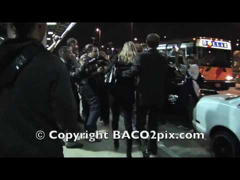 Kate Moss escape a mob of paparazzi at LAX