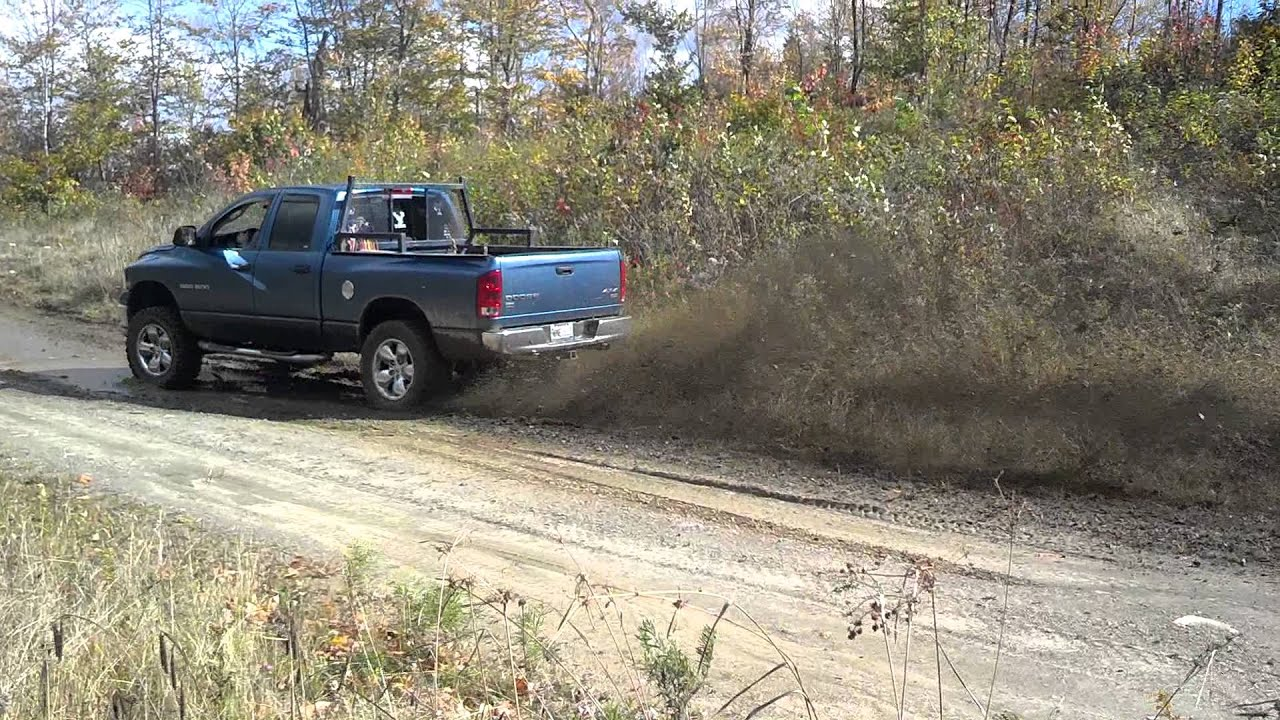 2004 Dodge Ram 1500 Lifted >> 2004 dodge ram 1500 hemi mud rooster tail - YouTube