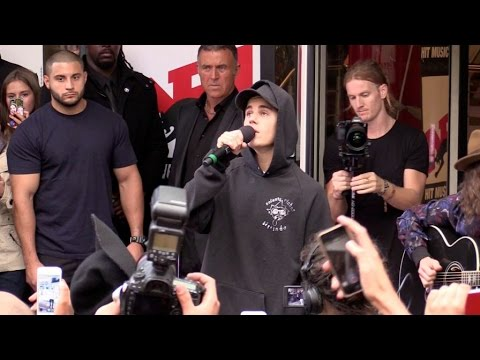 Justin Bieber performing As long as you love me live outside NRJ radio station in Paris