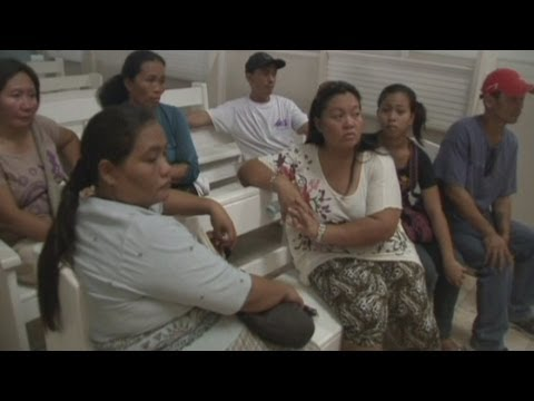 Philippines ferry crash: Families mourn ferry sinking victims