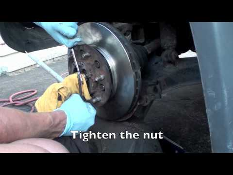 Nissan Xterra front brake rotor caliper removal and replacement.