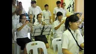 The Poi Lam High School Brass Band plays the School Song