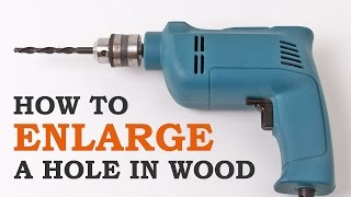 How to enlarge holes in wood