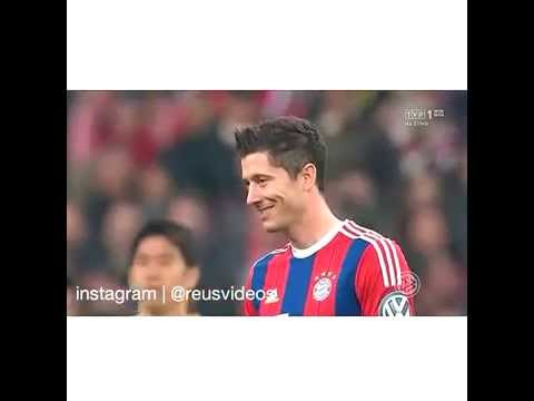 Marco Reus smiles to Robert Lewandowski